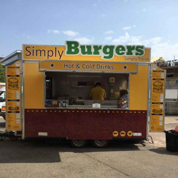 Mobile food unit selling burgers